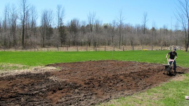 Doug Decker tilling the vegetable garden